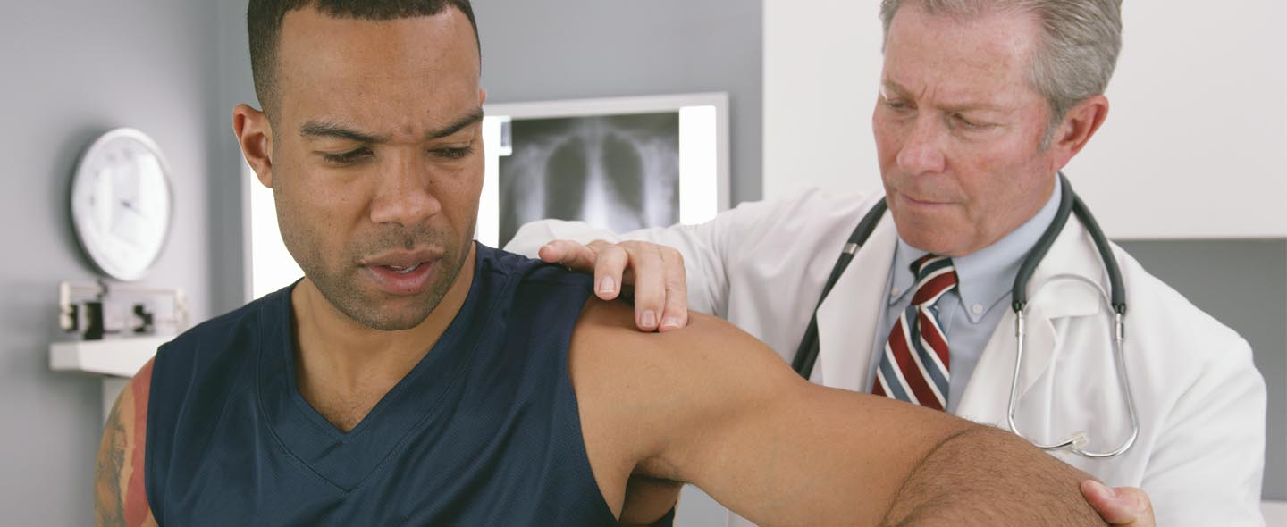Athlete having a shoulder check up