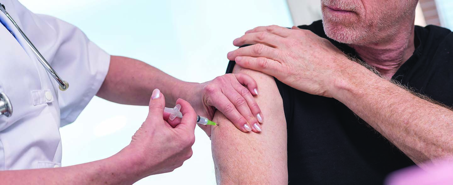 An adult having an intramuscular shot